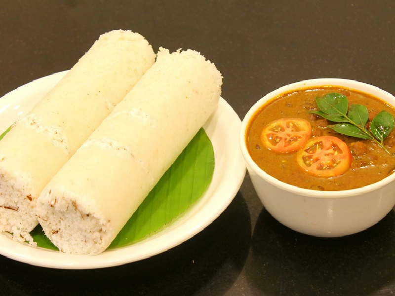 This image has an empty alt attribute; its file name is Puttu_with_Kadala_Curry_Main.jpg